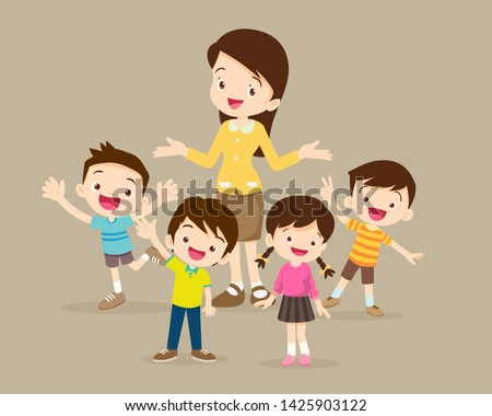 Teacher and kids.Childrens stand around teacher.Boy and Girl happy with teacher.