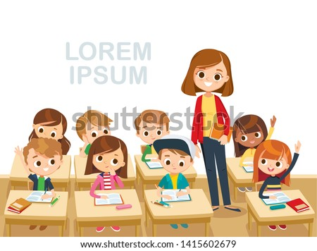 Teacher with pupils in a classroom stand in aisle. Primary school kids. Pupils raising hands. Teacher taking class. Back to school. Primary school kids.