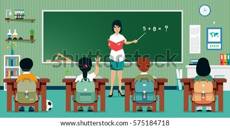 young teacher in the classroom who gives a lesson of mathematics
