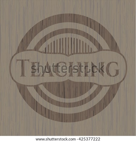 Teaching badge with wooden background