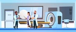 Team Of Doctors Over Mri Machine Scanner Hospital Room Inteior