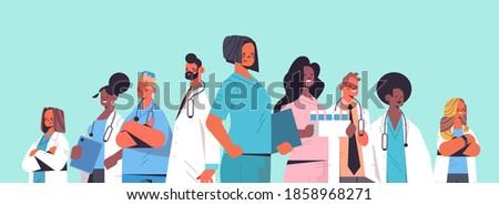 team of medical professionals mix race doctors in uniform standing together medicine healthcare concept horizontal portrait vector illustration Photo stock ©