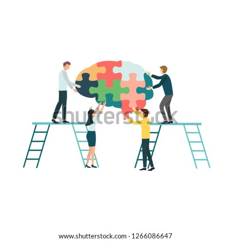 Teamwork group of people assembling a brain jigsaw puzzle. Concept for cognitive rehabilitation in Alzheimer disease and dementia patient.