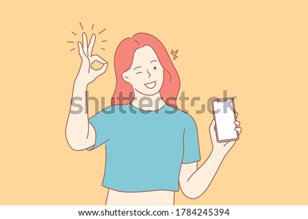 Technology, advertisement, communication, presentation concept. Young happy woman girl character shows smartphone with ok sign and winking. Promotion of innovative technological devices demonstration.