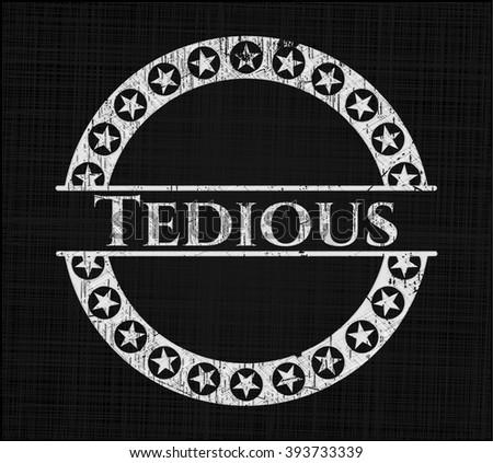 Tedious chalkboard emblem written on a blackboard