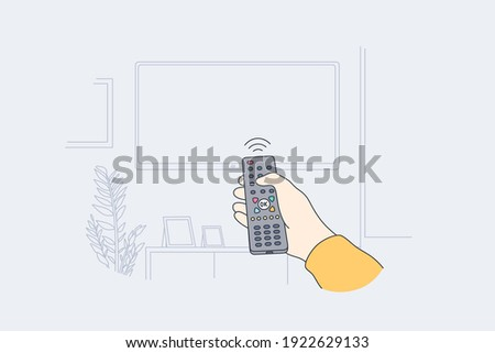 Television, home entertainment concept. Human hand with tv remote control switching television on at home for watching movies and programs vector illustration  Stockfoto ©