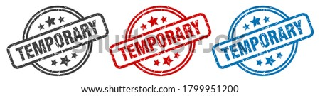 temporary round grunge vintage sign. temporary stamp ストックフォト ©