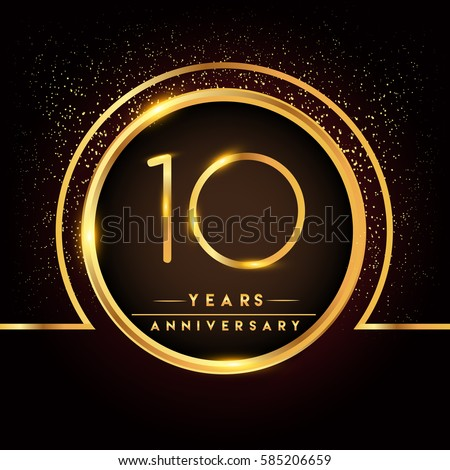 ten years birthday celebration logotype. 10th anniversary logo with confetti and golden ring isolated on black background, vector design for greeting card and invitation card. ストックフォト ©