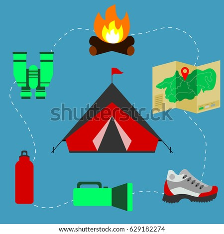 Tent surrounded with camping or outdoor equipment