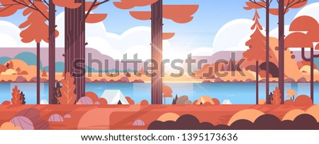 tents camping area in forest summer camp concept sunny day sunrise autumn landscape nature background with water mountains and hills flat horizontal