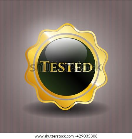 Tested gold emblem