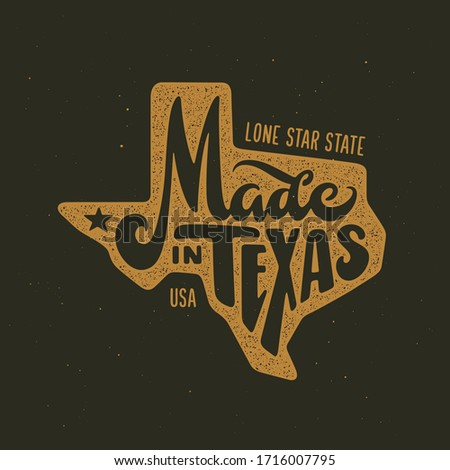 Texas related t-shirt design. Hand drawn lettering on dark background with vintage stamp effect. Made in Texas text. Vector illustration. ストックフォト ©