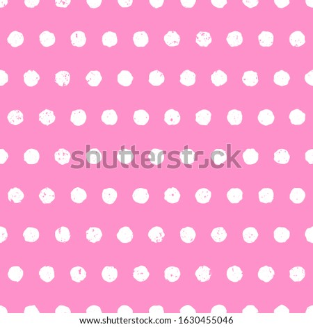Textured polka dot white on pink background. Cute seamless pattern with aged effect. Hand drawn doodle style. Vector illustration.