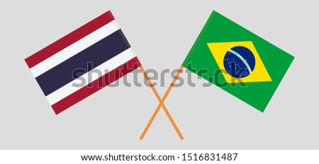 Thailand and Brazil. Crossed Thai and Brazilian flags. Official colors. Correct proportion. Vector illustration