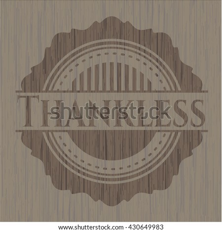Thankless badge with wooden background