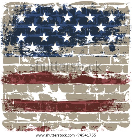 The American flag symbol against a brick wall.