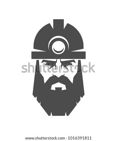 the bearded miner in a helmet