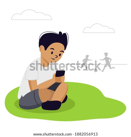 the boy is sitting on the grass