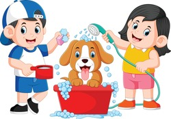the children are clean his dog with the soap and water in the pail