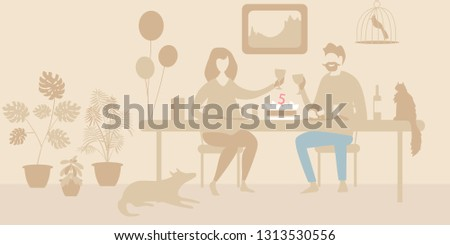 the couple celebrates the holiday at the table. man and woman celebrating the anniversary