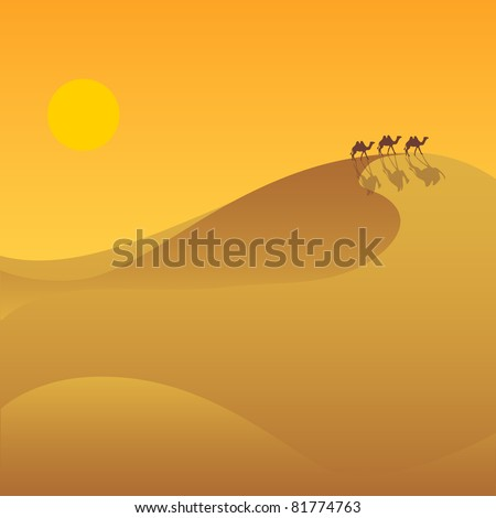 The desert valley with a caravan of camels.