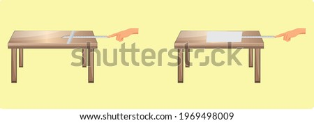 The gas pressure is tested by placing the folded newspaper on the ruler on the table Stok fotoğraf ©