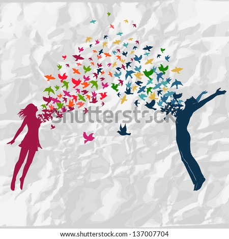 Stock Photo The girl and boy jumping with swarm of birds.