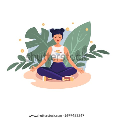 the girl meditates sitting in
