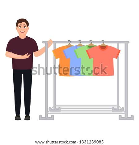 The guy shows off a wardrobe of t-shirts, a man sells t-shirts, a clothes hanger, a character in a cartoon style.