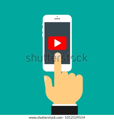 The hand clicks on the screen of the smartphone. Play button