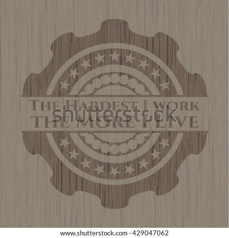 The Hardest I work the More I Live wood emblem. Retro