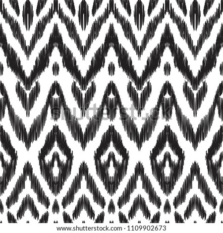 The intricate ikat pattern on ethnic style. Vector illustration in black and white color palette. Exquisite seamless texture can be perfect for background images, wallpapers, textiles, wrapping papers