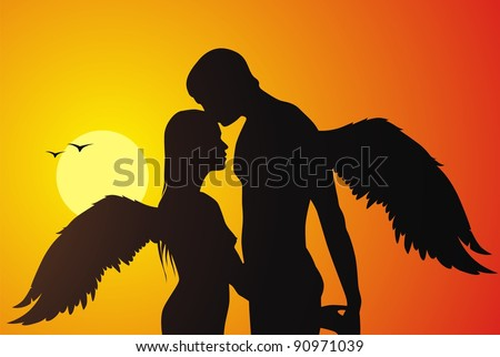 The loving couple of angels kisses against a sunset