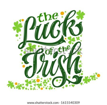 The luck of the Irish - hand drawn vector St Patrick's day lettering phrase, leprechaun hat shape design. Shamrock, lucky clover decor. Vector festive illustration. Spring festival. Сток-фото ©