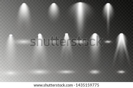 The spotlight shines on the stage. light exclusive use lens flash light effect. light from a lamp or spotlight. lighted scene. podium under the spotlight.
