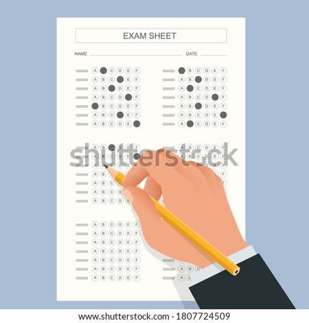 The student filling out answers to exam test answer sheet with a pencil. School and Education. Test score sheet with answers