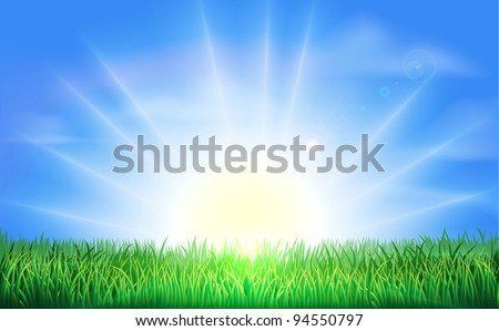 The sun rising or setting over a beautiful green field of grass with bright blue sky