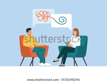 Therapist and patient talking together, she is helping him to cope with a stressful situation