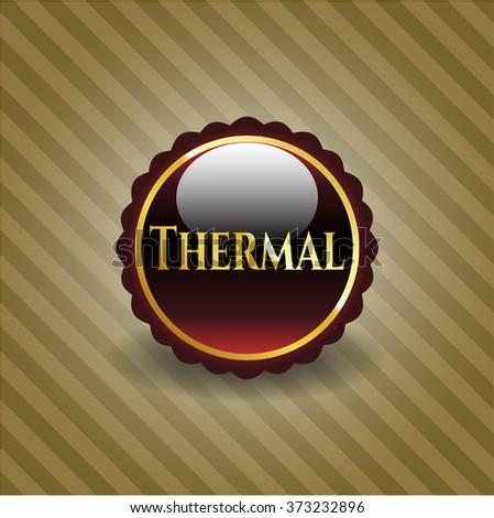 Thermal gold badge or emblem