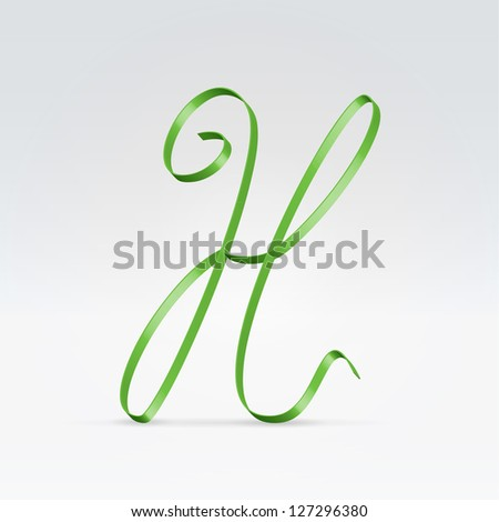 Thin green satin ribbon typeface capital H letter hanging over light background