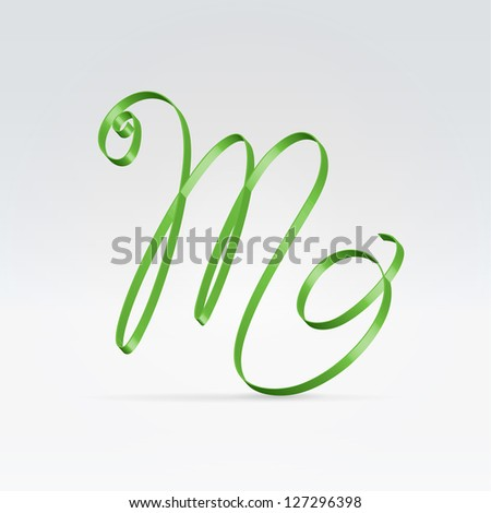 Thin green satin ribbon typeface capital M letter hanging over light background