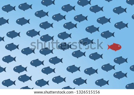 Think differently -One red unique different fish swimming opposite way of identical blue ones.