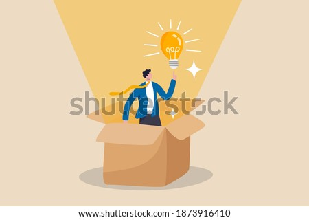 Think outside the box, creativity to create different business idea or motivation and innovation concept, smart businessman get out of paper box with new illumination lightbulb idea.