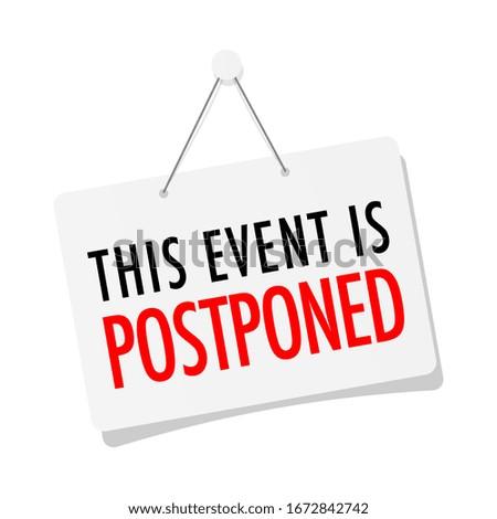 This event is postponed on door sign hanging Stockfoto ©