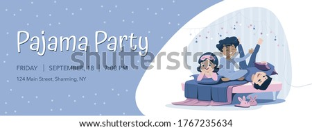 Three cheerful kids of diverse races in blue nightwear lie on the bed, having pajama party. Sleepover and slumber party horizontal banner template. Stock photo ©