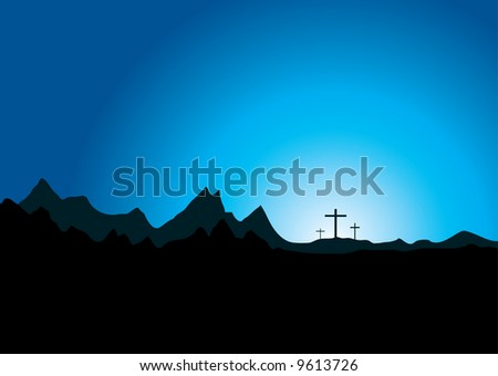 Three crosses in the distance set against a mountain range