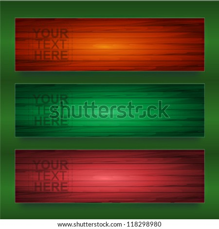 Three different colors wooden textures banners over green background