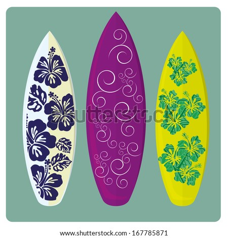 three different surfboards with