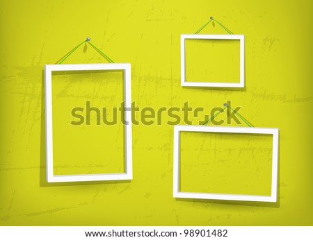 three empty frame of picture on the yellow old wall eps10 used opacity layers