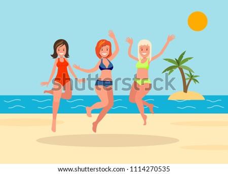 three girls jump on the beach